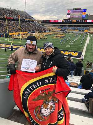 Eva attended West Virginia Mountaineers vs. Oklahoma State - NCAA Football on Nov 23rd 2019 via VetTix